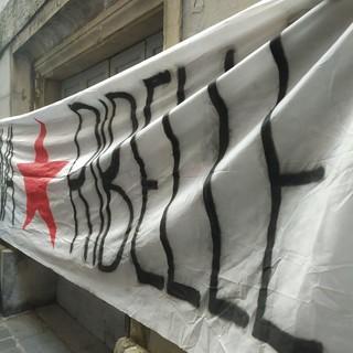 Striscione dei militanti del centro sociale Terra di Nessuno